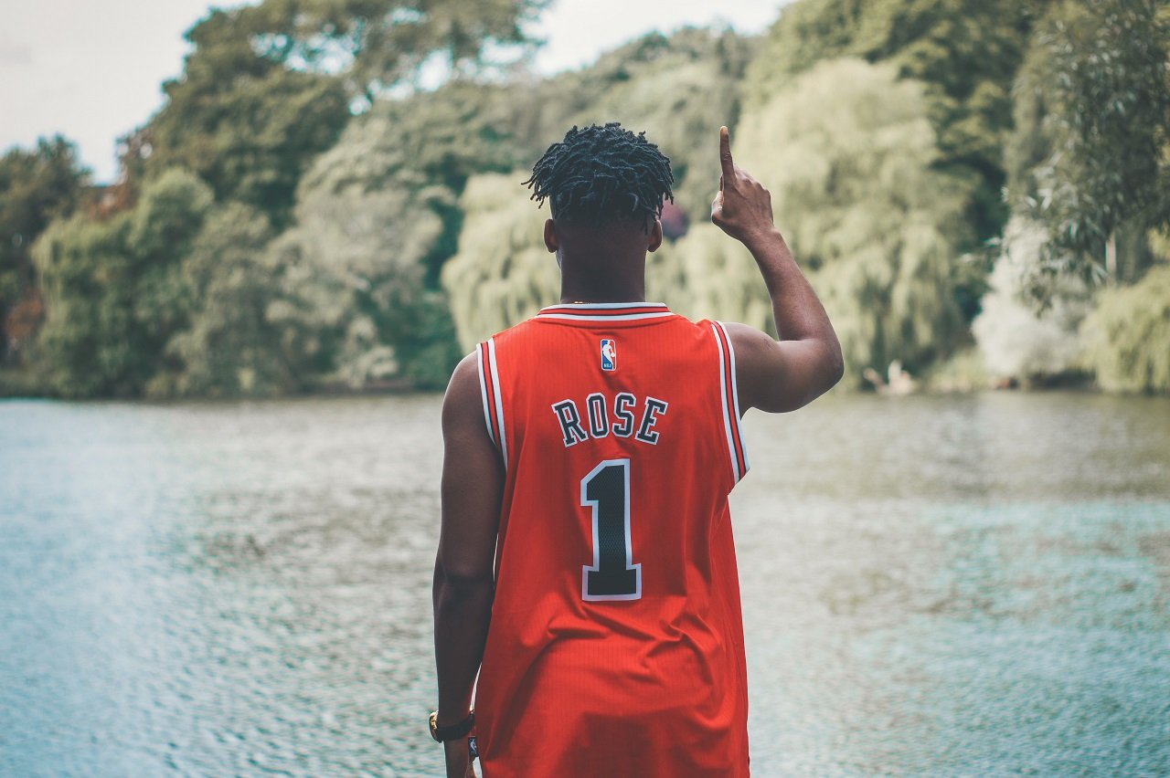 man with red basketball jersey image